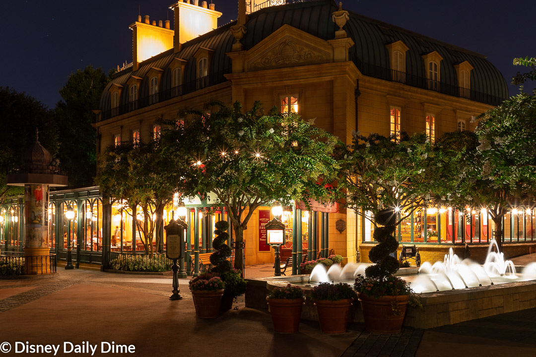 Exterior view of Chefs de France in Epcot at night.