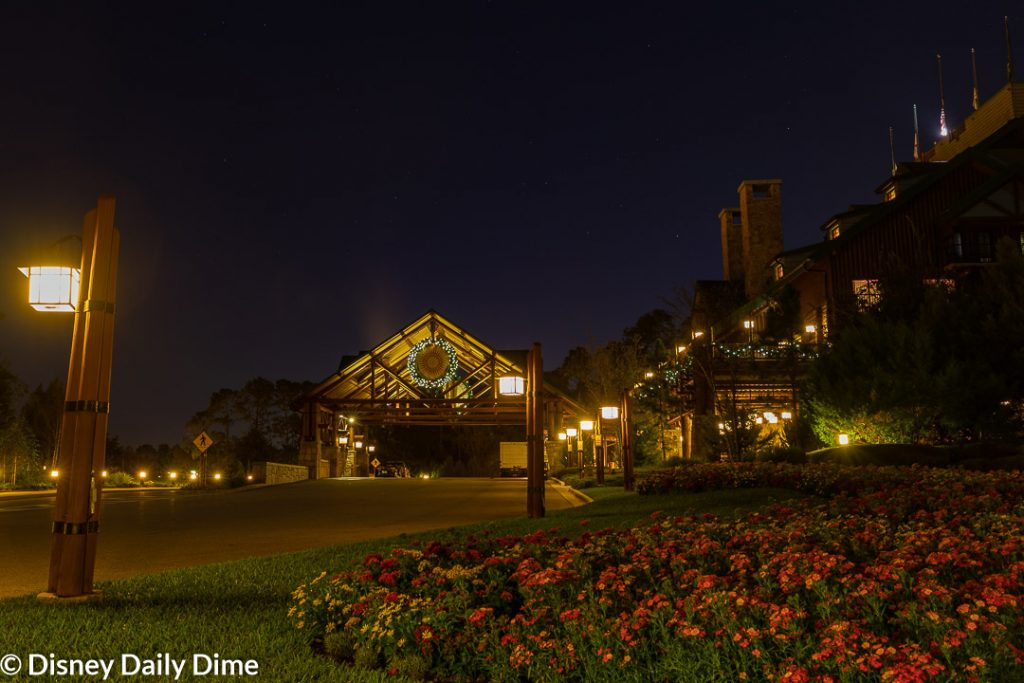 The front drive of Wilderness Lodge at Christmas during the evening.