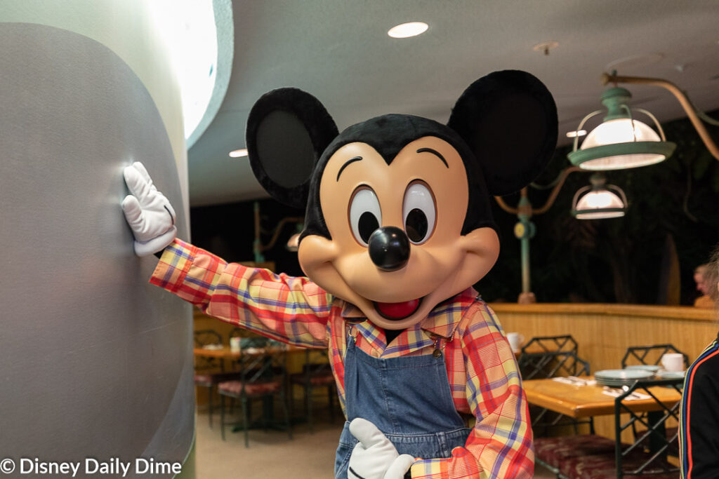 Mikcey Mouse meets at Garden Grill as part of a character meal.