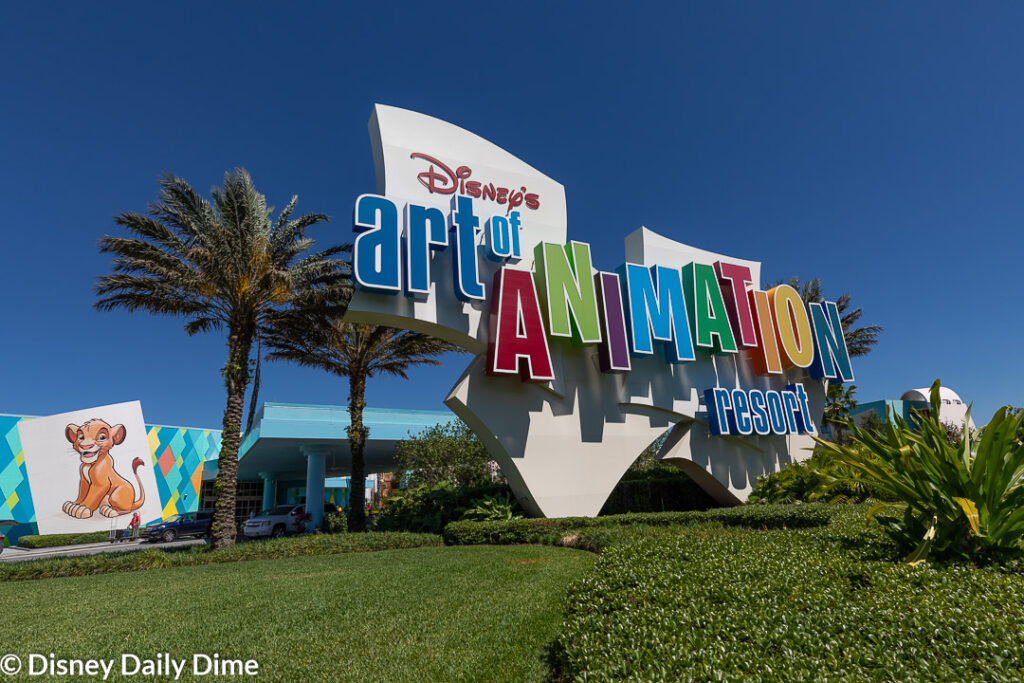This image shows the sign leading to the entrance of Disney's Art of Animation Resort.