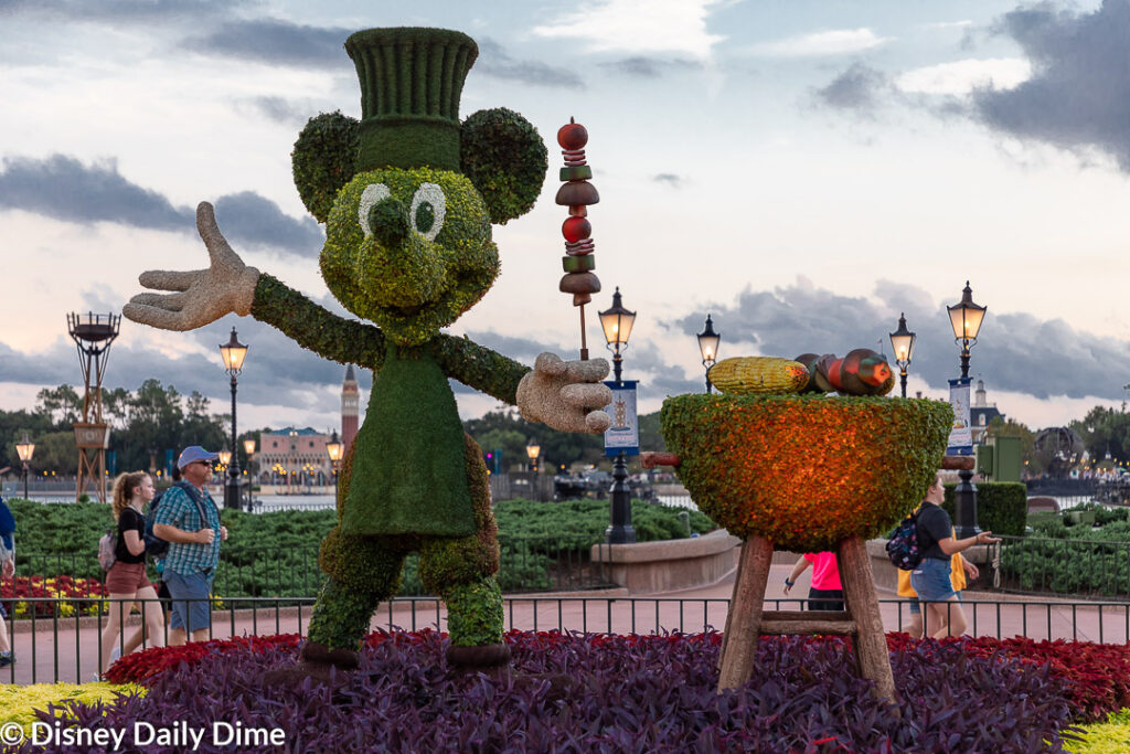 Mickey greets guests while working the BBQ pit at the Epcot Food & Wine Festival.