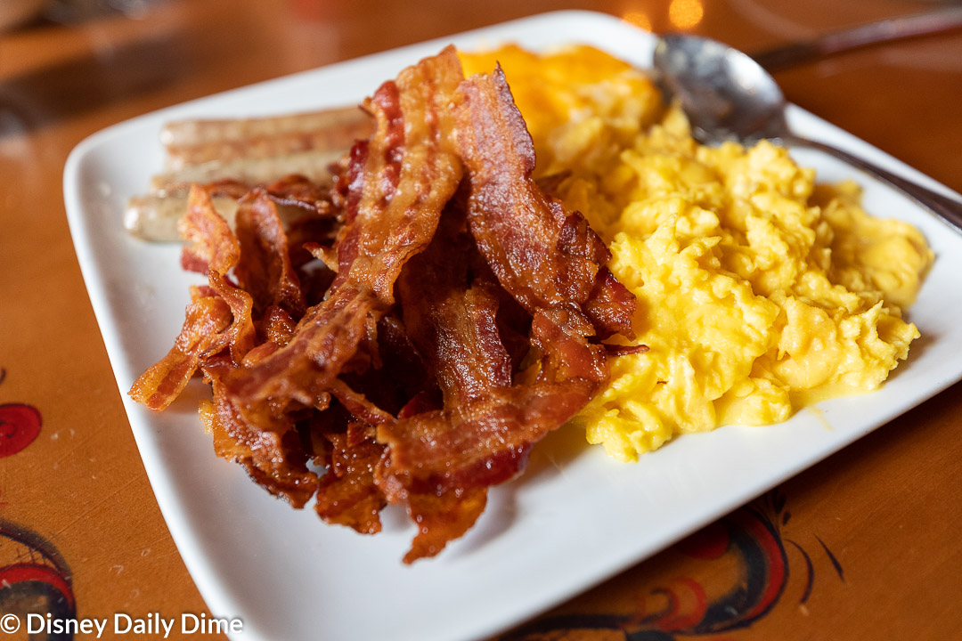 The plat features eggs, bacon, sausage, and potato cassarole.